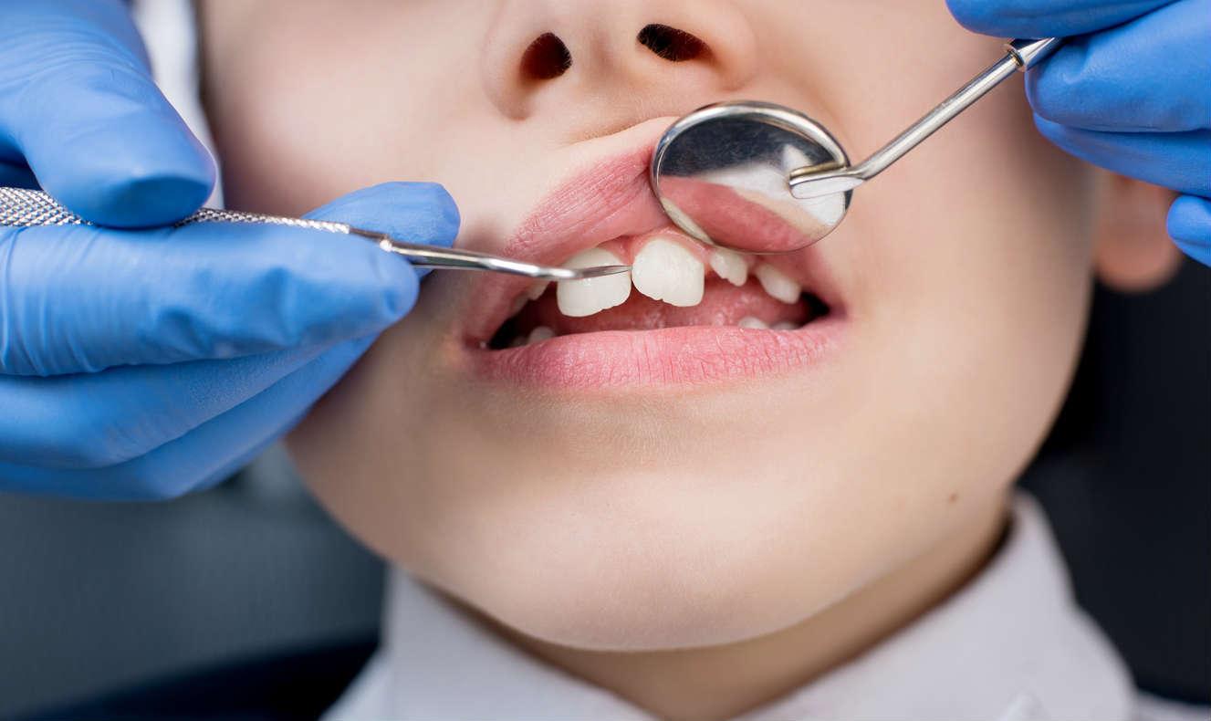 child with sensitive teeth