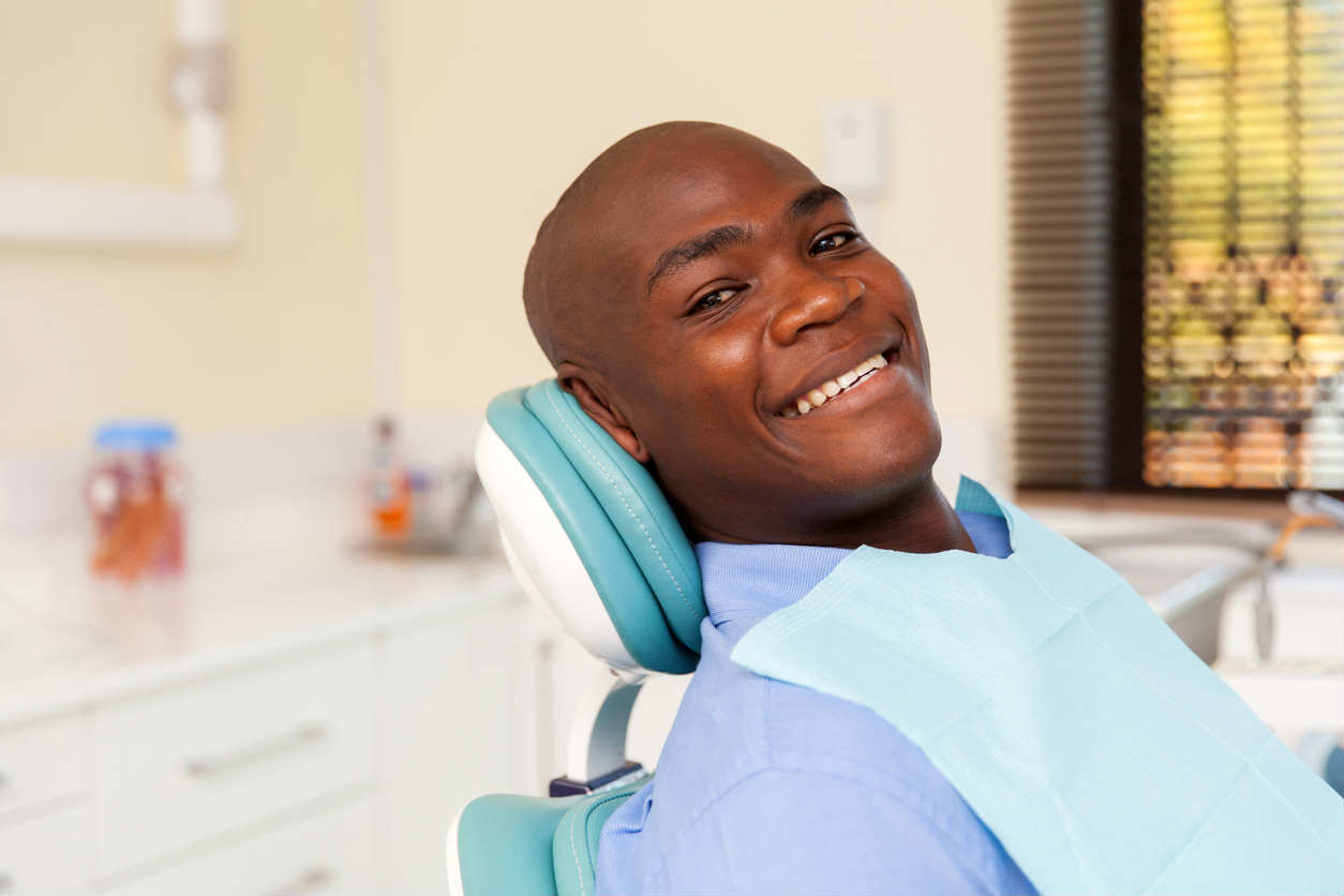 St. Louis man smiling at dentist